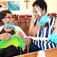 Older people enjoyed various bonding therapeutic activities: quiz questions for brain stimulation; Bingo, for alertness and concentration;  dancing for physical exercises; knitting for relaxation, exercising fingers  and eye coordination