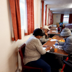 Older people enjoy various activities at the Day Centre including written quizes for mental stimulation to improve memory