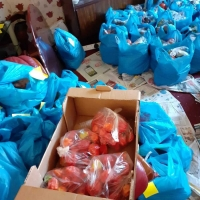 Arranging and packing cultural foods & home essentials parcels at home