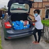 Packing parcels in the cars ready for deliveries