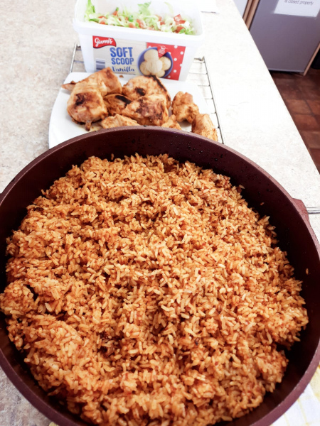Ghanian Jollof rice prepared by another older person