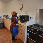Older person teaches the rest how to cook her favorite Ghanaian dish