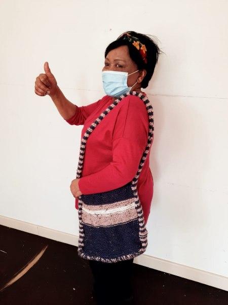 Elder displaying the handicraft she made