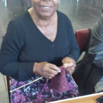 Elder making handicrafts to exercise fingers and hand coordination