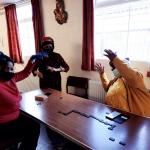 Elders having fun playing board games